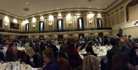 ballroom of conference attendees