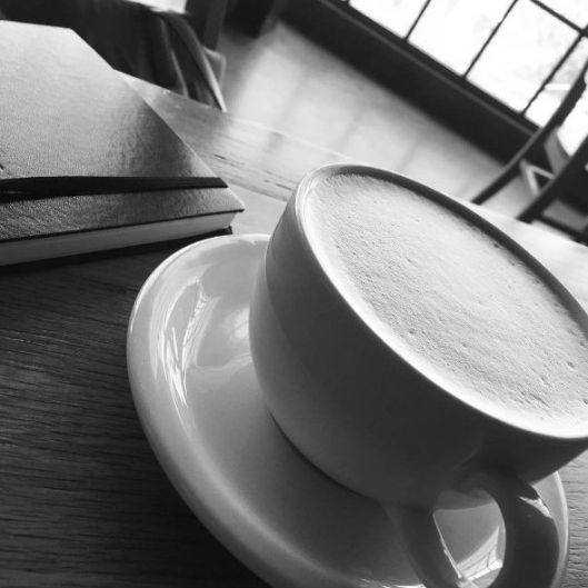 journal and latte
